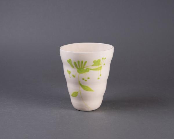 grønn vid vase