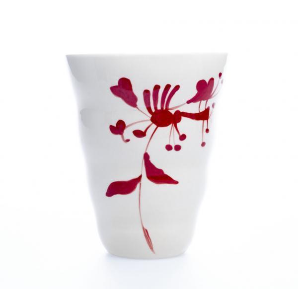Vid vase rød blomst